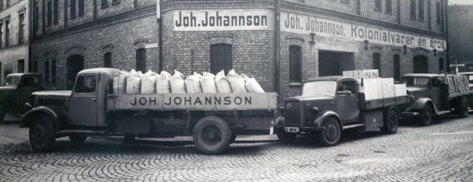 Bilder kjører kaffesekker i gamle dager