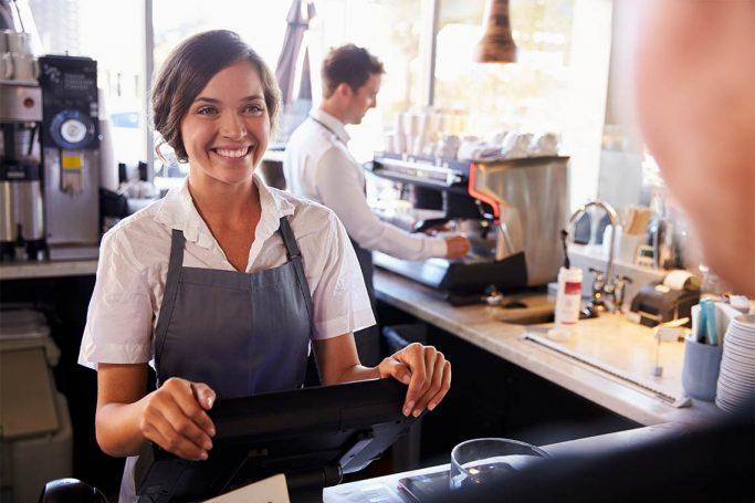 Smilende barista